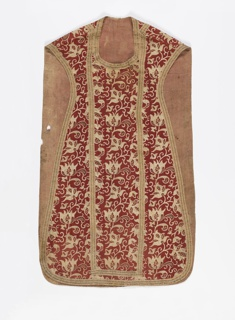 Chasuable printed in a dull brick red color showing a design of vine and flower. Tulip-like blossoms are rendered in natural size and have faded green and dark red interior decoration Trimmed with one-inch wide braid of natural color linen with flat gold woven in. Lined with rose-colored glazed linen.