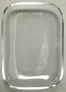 Rectangular form with up-curved sides; thin clear glass.