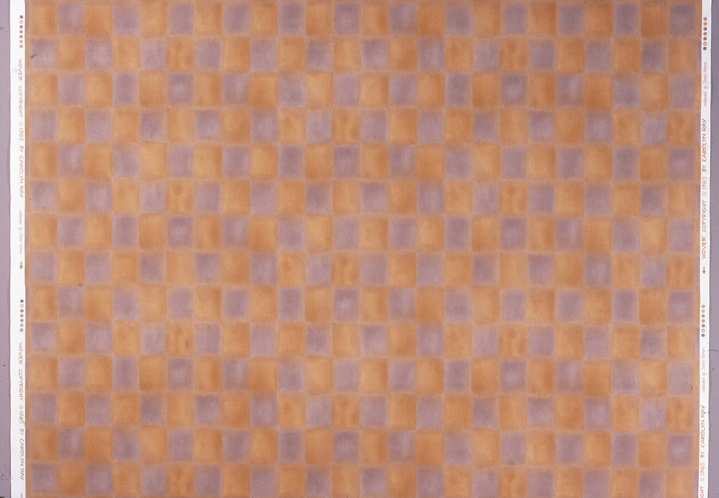 Blurred checkerboard of mustard yellow and grey squares.