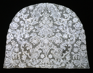 Cap crown with a pattern of floral and foliated forms forming a frame for a central, stylized bouquet.