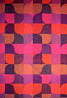 Multi-color pattern with pink, orange, and deep blue predominating, of modulated curves and squares.
