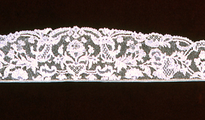 Sleeve ruffle shaped border  with large floral sprays in a repeat pattern.