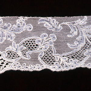 The design shows symmetrical scroll-work with interlacing floral sprays.