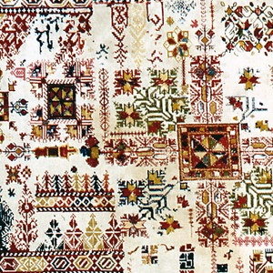Embroidery sampler showing a large series of the various motifs, including stylized florals and geometric shapes with square motif at centre. Double running and satin stitches in red, green blue and yellow.