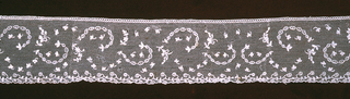 Border with a design  of dots and leaves powdered over the ground. Edging is a narrow garland of ribbon and sprays.
