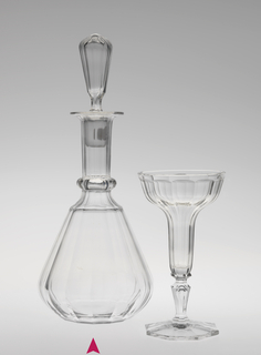 Mouth-blown crystal decanter with stopper, elaborately facet-cut and polished, with precisely planned bubble in the stem.