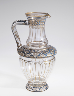 Enameled glass pitcher with blue, white, and gold foliate design, possibly of Near Eastern influence.