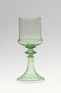 """Mouth-blown crystal wine glass, cut and polished ornamental engraving in the """"Greek"""" style in green."""
