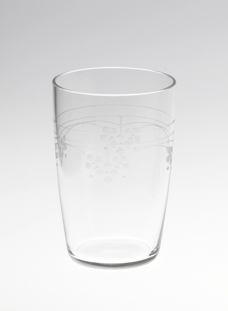 Mouth-blown crystal water tumbler, with dainty floral engraving.