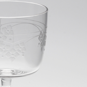 Mouth-blown crystal wine glass, with dainty floral engraving.
