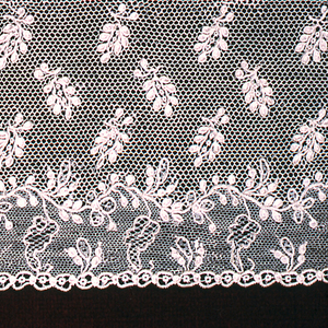 Border  with floral sprays forming garlands and edgin one border. Isolated sprays powdered over remaining area.