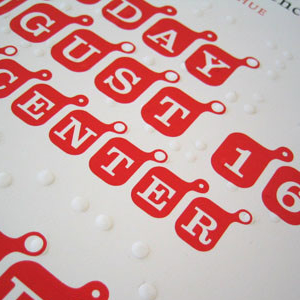 Text in white on red rounded squares and embossed Braille above: TOUCHING / GRAPHIC DESIGN; A Hybrid Print and Tactile Publication / created by / SEAN DONAHUE; A TACTILE / READING / LA TIMES AUDITORIUM / ART CENTER.