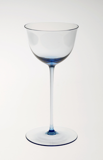 """Thin blown crystal (""""Muslin glass"""") wine glass with thin, long stem and relatively large round base."""