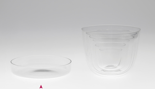 Thin mouth-blown crystal wine tumbler.