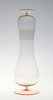 Simple, tall bottle (a) of thin-bodied, pink-tinted clear glass, the tapering cylindrical neck flaring into bulbous belly above short stem with circular foot; matching ovoid drinking glass  (b) with short stem and circular foot can be inverted to sit in mouth of bottle as fitted stopper.