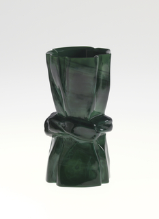 "Mold-blown ""stone"" black-colored glass beaker with pinched waist."