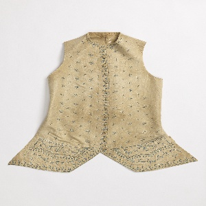 Waistcoat with embroidered floral garlands in blue and white centering around the pockets and below. Widely-spaced floral sprigs across the body.