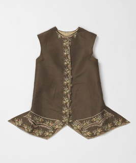 Man's waistcoat in dark brown silk with multicolored floral embroidery. Collarless cutaway style with scalloped pocket flaps.