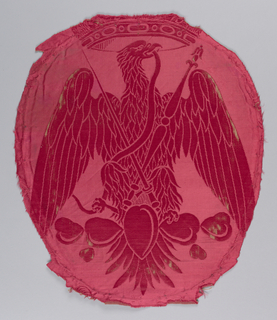 Eagle beneath crown holding a snake in its beak with crossed sceptres in front over an arrangement of cactus. Had previously been used as the back of a chair. All in dark red.