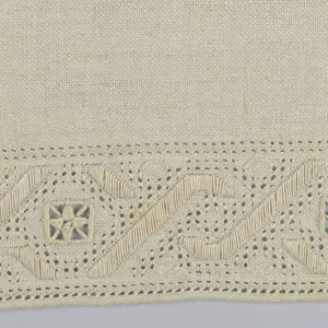 Sampler with an unfinished border of embroidery and cutwork.