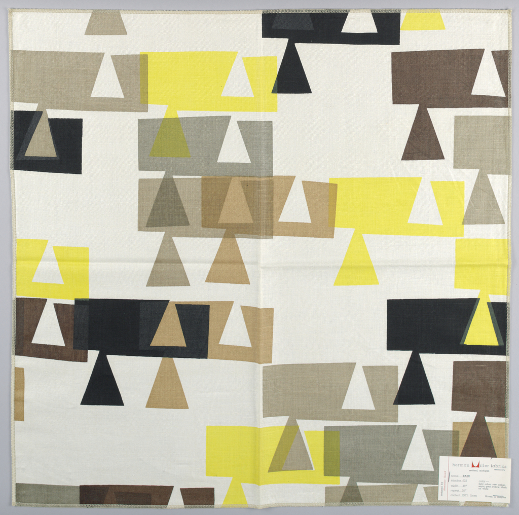 Rows of rectangles and trianges printed in brown, tan, grey, yellow and black on white ground. Serged on all 4 sides.