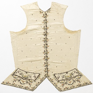 Left and right fronts of a gentleman's waistcoat with no collar, shaped lower edge and pocket flaps, embroidered in fourteen colors of silk with sequins and paste jewels on an ivory silk ground. Overall tiny floral sprig, floral border at center front, and design of sailing ships and swagged garlands at lower edge.