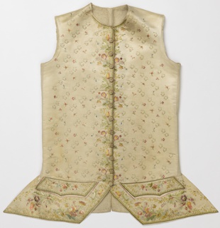 White satin waistcoat embroidered in multicolored silks. Floral border along bottom edge below the pockets. Detached floral motif runs along the center front. Twelve worked buttons. Cutaway style.