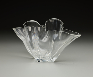 Clear blown lead-glass vase with irregular, undulating lip.