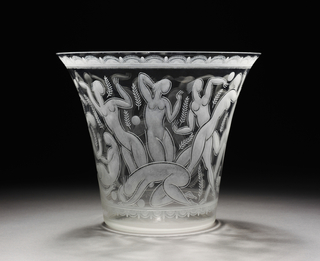 Etched vase featuring dancing figures, leafy stalks, and stylized border decoration.