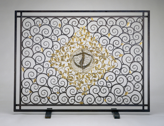 Firescreen with stylized curling tendrils contained within a rectilinear double border; at center, gilt leaves surround a nude figure holding a swag-like drape, smaller gilt tendrils, and a ring of gilt pearls.