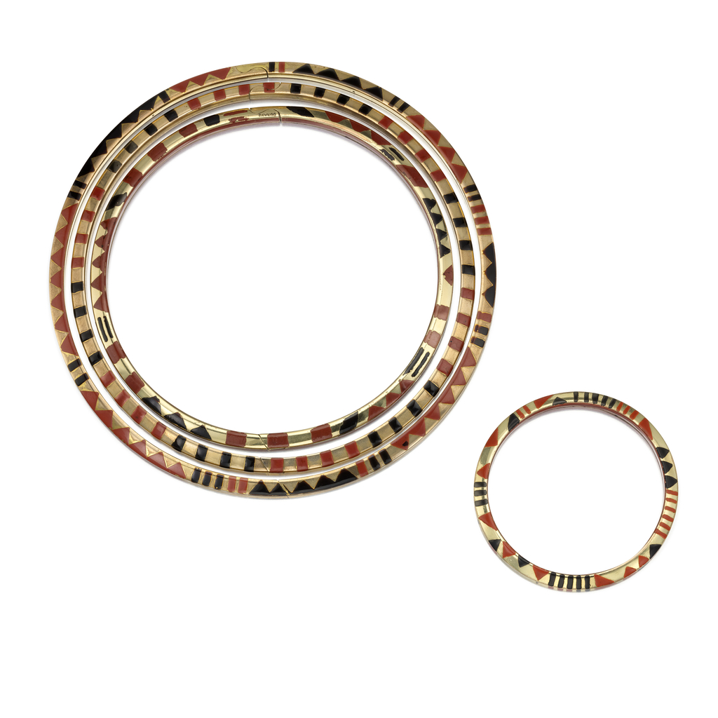 A set of three necklaces and three bracelets composed of abstract geometric patterns of red and black lacquer on Oréum (an alloy)