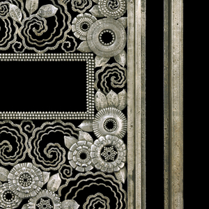 Iron door consisting of rectilinear frame on perpendicular legs; openwork panel tradecoration consists of concentric scalloped swirls, leaves, and stylized cog-like blooms with vertical elements at bottom and a slot at top articulated by rows of iron pearls.