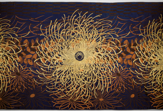Asymetrical golden chrysanthemum designs with orange silk lespedeza on a deep blue silk ground.
