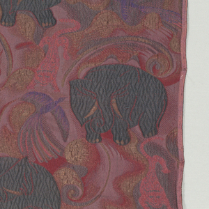Textile with elephants, wild cats, birds, and foliage.