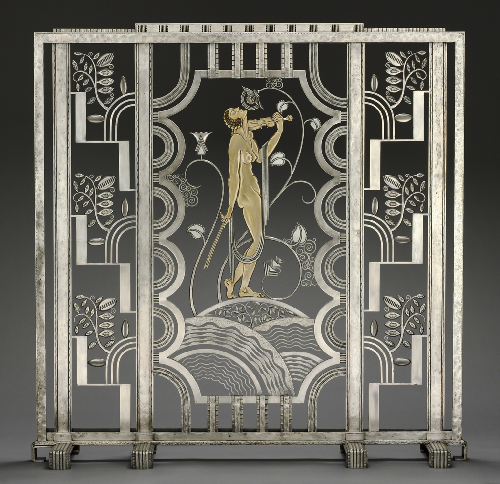 Wrought-iron screen depicting a muse with violin; the gold-plated figure at center stands on rolling hills of openwork decoration (foliate and scalloped) while concentric rings and rectilinear shapes hem the scene in. The two side panels consist of angular, stepped ornament with curving lines and stylized boughs, and the entire piece rests on four rectangular feet.