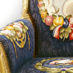 Giltwood Bergère chair with wool- and silk-upholstered image of an airplane, floral blooms, and swags.