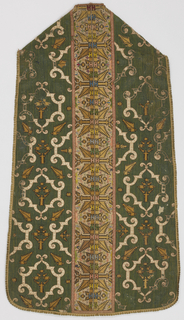 Chasuble of grass-green linen with symmetrical design in Renaissance tradition of applique white satin arabesques outlined with couched pink cord and applique stylized plant forms cut from rosettes similar to those in pillars, in gold-colored silk cross-stitch. Embroidered white linen? Pillars with vertical row of elaborate geometrical rosettes in gold-colored silk cross-stitch and floral fillings in pastel silks. Lined in dark blue glazed linen. Narrow linen galloons of period.