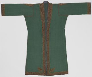 Long coat of green-blue twill wool that is open down the front with long sleeves, lined with green-blue silk, and edged with red and blue silk. The coat is patterned with set-in shapes embroidered in multicolored wool along the opening down the front and sleeve bands. There are small medallions on shoulders and at the bottom corners of the front opening. There is a large medallion at the upper back near the near. The embroidered set-in pieces are probably from an older coat of higher quality, possibly 19th century. The foundation fabric of the embroidered shapes is a dull olive-green.
