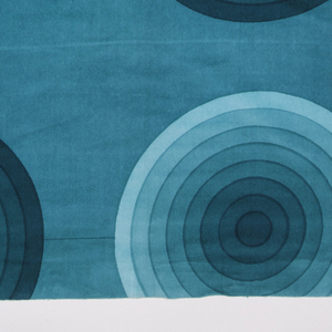 Large sample of silk-screen printed cotton velvet with a design of concentric circles in eight gradated shades of turquoise.