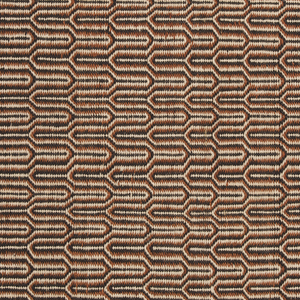 Blanket with all-over geometric interlocking pattern in black, white, and rusty brown.