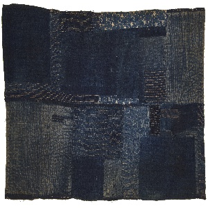 Child's sleeping mat composed of several layers of indigo dyed cotton fabrics, patched and heavily stitched.