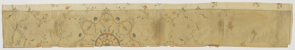 Fragment from the center of the panel in ivory-colored silk satin embroidered in polychrome silks to form a central medallion of large-size flowers framed by ribbons and flowering vines in a field of meandering vines.