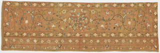Fragment from a hanging embroidered in multicolored silk and metallic thread on an orange ground. The design shows a European coat of arms set in a curving flowering vine with birds.