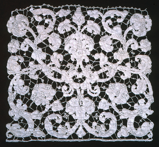 Fragment of stylized floral and foliated forms in a large scale symmetric scroll design. Pattern connected by brides, picotées, and is interspersed by gaze quadrillée and portes.