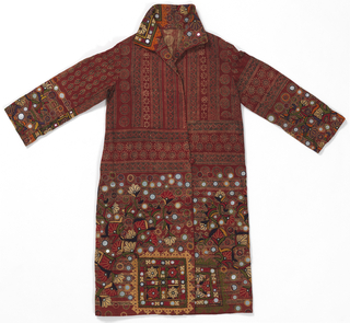 Man's coat, resist-dyed and block printed in red and black on cream ground in all-over border patterns. The collar, cuffs and hem are decorated with multi-colored silk embroidery with mirrors in floral and geometric motifs.