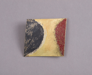 Black and red enameled brooch