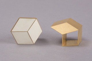 Cube on cube-form gold ring with white faces.
