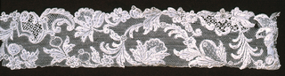 Fragment of a narrow band with a floral vine pattern.