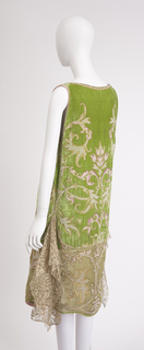 Evening dress in acid green silk velvet; gilt metallic, glass pearls and silk floss embroidery