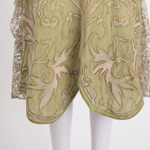 Evening dress in acid green silk velvet; gilt metallic, glass pearls and silk floss embroidery